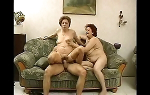 2 grandmas enjoy a hunk added to his cock.